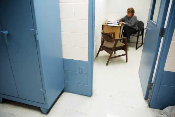 Androscoggin County Jail social worker Lynn Tijssen fills out paperwork to take an inmate off suicide watch on Wednesday in Auburn.