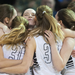 Houlton players celebrate after defeating Gray-New Gloucester in the Class B girls state championship basketball game on Friday at the Cross Insurance Center in Bangor.