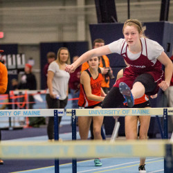 Girls hurdles winner Lauren Stoops             of Orono High School flies over a hurdle during the finals race at the PVC-EMITL Championship Track and Field meet on Monday in the New Balance Field House at the University of Maine. Stoops finished at 8.70 seconds.