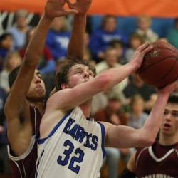 Hodgdon's Jimmy Buzzell (front) poured in a game-high 27 points Wednesday in a Class C North prelim against Narraguagus. Defending on the play is the Knights' Chris Smith. Hodgdon won 62-59.