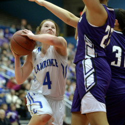 Lawrence's Morgan Boudreau (left) charges to the net under the defense of Hampden's Bailey Donovan during their Class A North girls semifinal basketball game on Wednesday at the Augusta Civic Center.