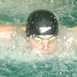 Ellsworth's Richie Matthews swims in the 100 butterfly during the  Class B state swimming and diving championships Tuesday at Bowdoin College in Brunswick. He finished third in the event and Ellsworth won the team title.