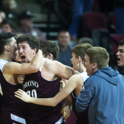 Orono's Jake Koffman (center) celebrates with teammates after defeating Old Town during their Class B North boys semifinal basketball game at the Cross Insurance Center in Bangor Wednesday.