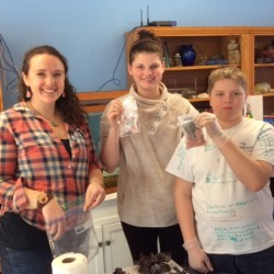 Carly and students in Herring Gut's seaweed aquaculture program show off their bath scrubs