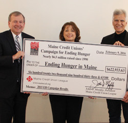 (L-R) John Murphy, President of the Maine Credit Union League, Vicki Stuart, Chair of the Maine Credit Union League's Social Responsibility Committee, which coordinates the Maine Credit Unions' Campaign for Ending Hunger, and Olympic Icon, Mark Spitz, hold the check revealing the record-breaking total that the Campaign raised in 2015 - $622,933.63.  Spitz was the featured speaker at the Results event held in Freeport.