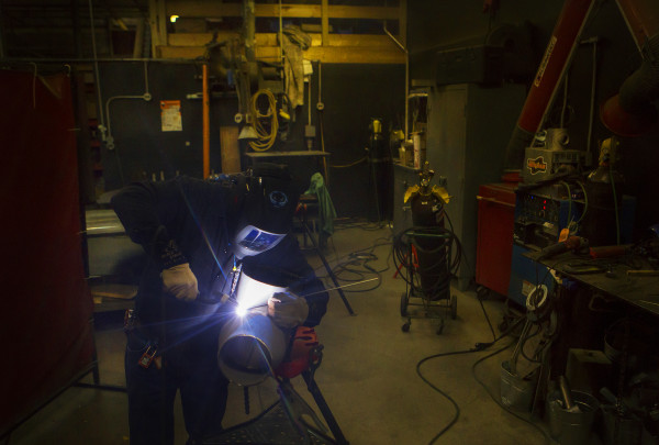 Tom Picard carefully TIG welds pieces of metal together during his 12-hour shift at the Huhtamaki plant in Waterville. Picard says he lives &quotthe new normal.&quot As a millworker, he has been laid off 10 times since 1980.