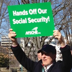 An AFSCME supporter holds a sign over his head at a rally in Senate Park, Washington, D.C., Feb. 12, 2013. (Cropped photo by Djembayz, used under Creative Commons license)