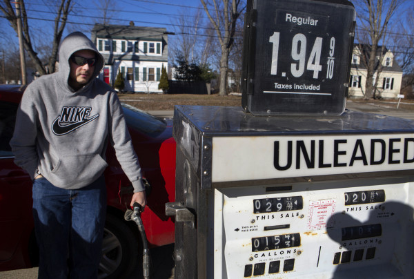 Gavin Dunphy fills his tank up at C.N. Brown's gas station in Pittsfield Tuesday for $1.94 per gallon. Gas prices continued to fall another 8.5 cents per gallon in the last week in Maine.