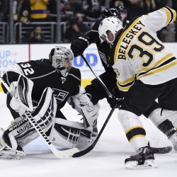 Boston Bruins left wing Matt Beleskey (39) battles with Los Angeles Kings defenseman Jake Muzzin (6) in front of goalie Jonathan Quick (32) during the third period Saturday night at the Staples Center in Los Angeles. The Kings won 2-1.