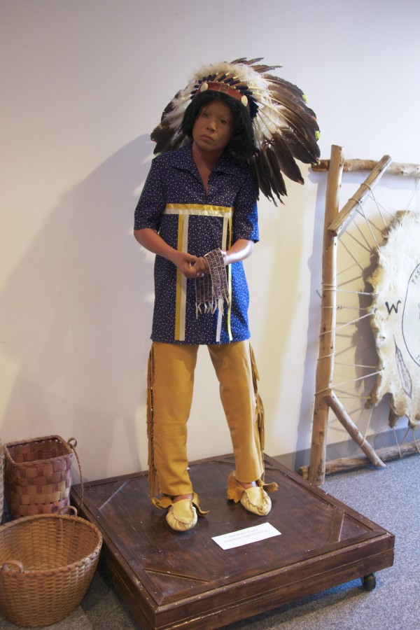 Joseph Mitchell Jr. modeled for this mannequin, which depicts modern Passamaquoddy dress. Brenda Moore Mitchell said the Passamaquoddy never wore headdresses like he has on but adopted the style from others. &quotIt's just for show,&quot she said.