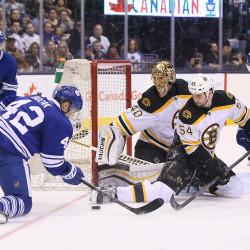 Toronto Maple Leafs center Tyler Bozak (42) tries to score as Boston Bruins defenseman Adam McQuaid (54) defends and goalie Tuukka Rask (40) guards the net Saturday night at Air Canada Centre in Toronto.
