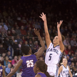 The University of Maine's Bella Swan (right) goes up for a shot over Albany's Shereesha Richards during their game on Feb. 14 at the Cross Insurance Center in Bangor.