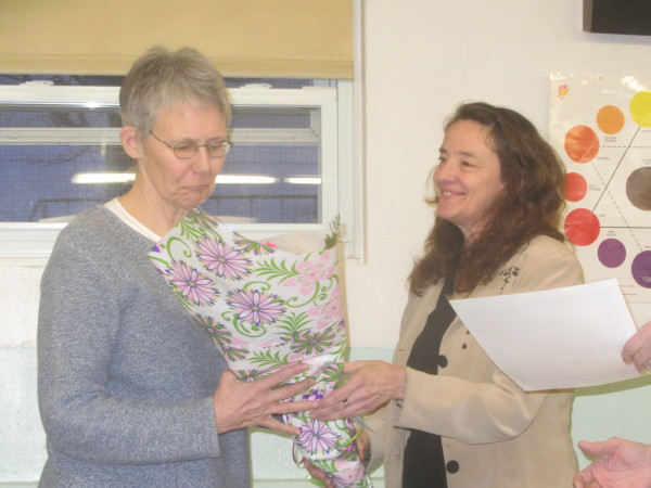 Outgoing Selectman Dorothy Meriwether, left, was presented a bouquet of flowers at the start of the Tuesday night annual town meeting in South Thomaston by Town Administrator Terri-Lynn Baines.