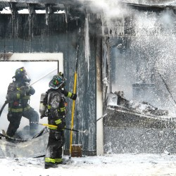 Firefighters battle garage blaze in Blue Hill