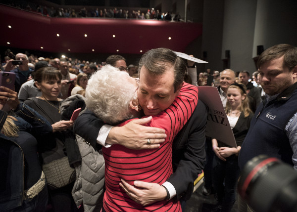 Republican presidential candidate Sen. Ted Cruz (right) hugs a supporter during a campaign rally on Friday at the University of Maine in Orono.