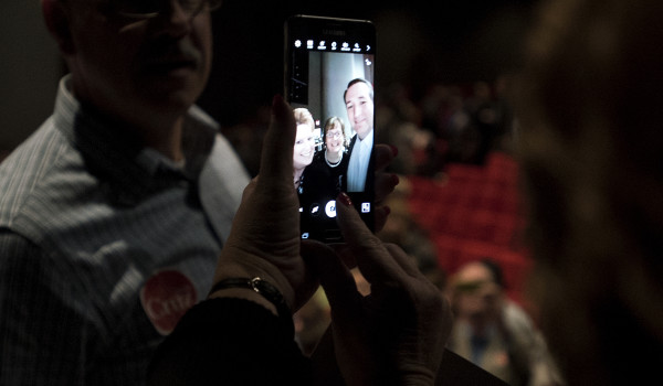 A supporter takes a selfie with Republican presidential candidate Sen. Ted Cruz (right) during a campaign rally on Friday at the University of Maine in Orono.