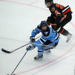 The University of Maine's Cam Brown (left) moves the puck around Princeton University's Tommy Davis during a game last November in Orono. Brown scored a power-play goal in Maine's 4-3 overtime loss to Northeastern in the Hockey East playoffs Saturday night in Boston.