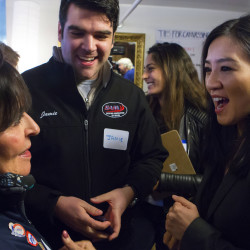 Bridget Woodward (from left) and Jamie Wren chat with Olympic figure skater Michelle Kwan after Kwan spoke in support of Hillary Clinton in a conference room in the Charles Inn in Bangor on Tuesday.