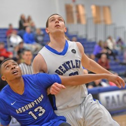 Tyler McFarland (right) of Bentley University battles for position to grab a rebound during a game. The senior from Rockport is among six former Maine high school stars who have helped the Falcons reach the NCAA Division II tournament.