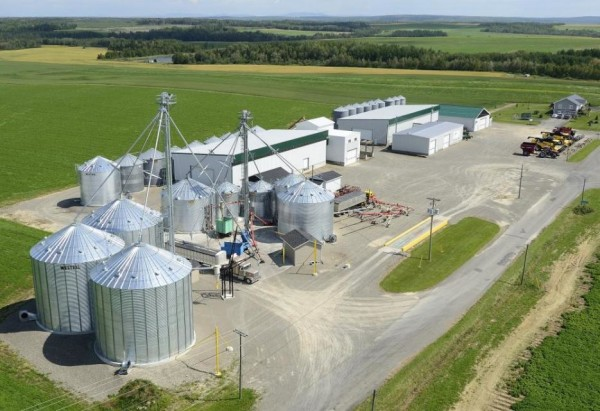 The grain farm and processing facility of Eastern Grains Inc., in Drummond, New Brunswick, about 30 miles northeast of Van Buren. Robert Theriault built the grain seed and equipment business in the 1980s, after almost going bankrupt growing potatoes, and his son Eric runs it today.