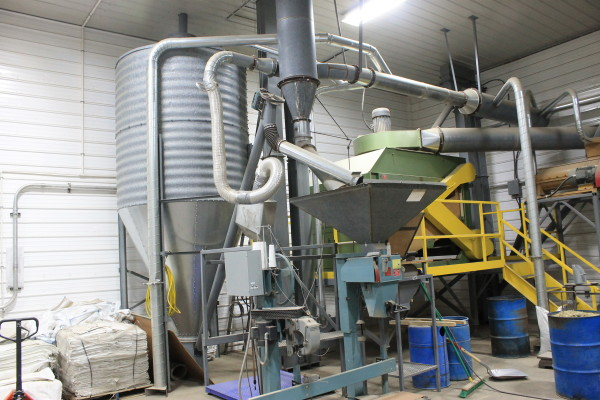 Space at Buck Farms in Mapleton that used to store potatoes is now a grain cleaning system at the farm's Maine Malt House, producing malted barely for beer brewers around the state.