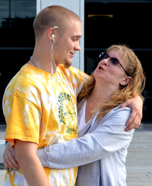 Garrett Brown, 21, hugs his mother, Traci, June 30, 2015. Garrett was among the 272 people who died in Maine in 2015 as the result of overdosing — a 31 percent jump over 2014, which saw a record 208 overdose deaths.