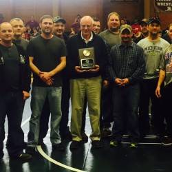 Former Penobscot Valley High School wrestling coach Gerald Hutchinson (center, with plaque) was recognized for his recent induction into the New England Secondary School Principals' Associations Wrestling Hall of Fame Saturday at PVHS in Howland. With Hutchinson are former PVHS wrestlers (from left) Doug Dyer, Brad Thibodeau, Ken Mitchell, Corey Harper, Andy Harding, Dakin Magoon, Nick Boobar, Darren Thibodeau, Chip Dugans, Chris Sirois, Wes Dube, Greg Rowley and T.J Langerak.