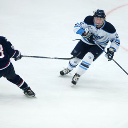The University of Maine's Dan Renouf (right) moves the puck past the University of Connecticut's Joey Ferriss during their game on Jan. 16 at Alfond Arena in Orono. Renouf, Maine's top defenseman, finished with six goals and nine assists and will return for  his senior season next year.
