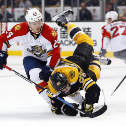 Boston Bruins defenseman Kevan Miller (right) is spilled by Florida Panthers left wing Jiri Hudler during the second period Thursday night at TD Garden in Boston.
