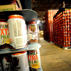 Empty cans are ready to be filled in a back storage area of Baxter Brewing in Lewiston.