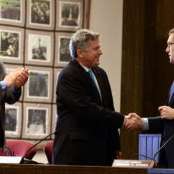 Sean Faircloth (center) shakes hands with Ben Sprague (right) after being selected as the new Bangor City Council chairman during the swearing-in ceremony in November 2015 at City Hall in Bangor. David Nealley looks on.