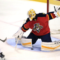 Florida Panthers goalie Roberto Luongo (1) gives up a goal to Boston Bruins left wing David Pastrnak (left) in the first period Monday night in Sunrise, Florida.