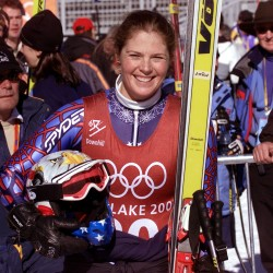 Picabo Street of the U.S. smiles in the finish area of the Olympic women's downhill course at Snowbasin, in this file photo taken February 9, 2002. Assault and domestic violence charges filed against Street after an altercation with her father earlier this year are expected to be dismissed in court, her attorney said on Friday.