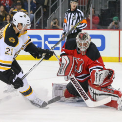 New Jersey Devils goalie Keith Kinkaid makes a save on Boston Bruins left wing Loui Eriksson during the first period Tuesday night at the Prudential Center in Newark, N.J.