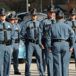 Maine State Police leaders inspect the troopers and their vehicles at the Air National Guard base in Bangor in this October 2014 file photo.