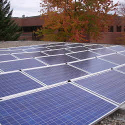 Solar electric panels on a ballasted racking system are ideal for flat roofs