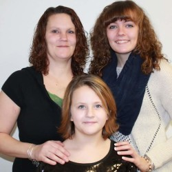 Shannon Eberhart (back, left) with her daughters Kaylah (back, right) and Kelsey.