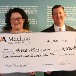 Machias Savings Bank Branch Manager Matt Horton presents Abbe Museum President and CEO Cinnamon Catlin-Legutko with a check in support of the Abbe's free admission program.