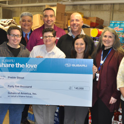 Patriot Subaru visits Preble Street to present a check from the Subaru Share The Love Event.