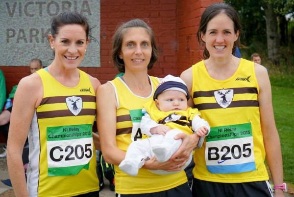 Gladys Ganiel (center) holds her son Ronan after she and teammates Breege Connolly (left) and Martsie Hell competed in the Northern Ireland road relays in October 2015 at Victoria Park in Belfast, Northern Ireland.