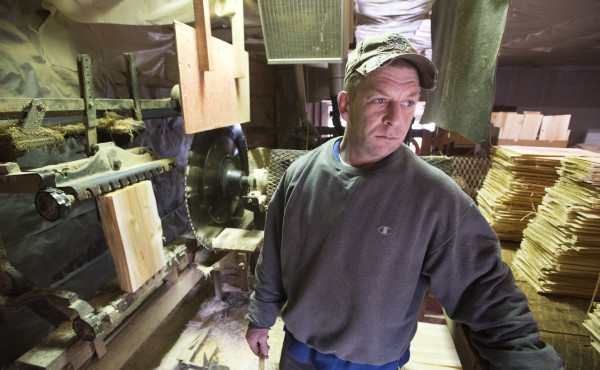 Eric Snow runs the shingle mill at the H.O.M.E. cooperative in Orland. Snow has been working there for nearly eight years.