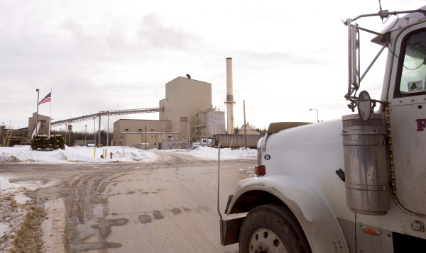 A truck delivers wood chips to Covanta Energy's West Enfield facility in January. The company decided to shut down the West Enfield and Jonesboro plants because of low energy prices.