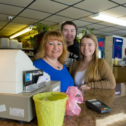 Michelle Hanson, owner of Frederick's Southside, recently won U.S. Small Business Administration's Woman Owned Small Business of the Year award for the state of Maine. Hanson stands behind the front counter with her two children Paul and Danielle, who often help with the restaurant.
