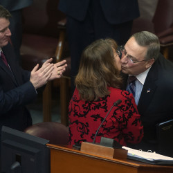 Gov. Paul LePage gives a kiss to a lawmaker after the 2015 State of the State address Tuesday at the State House in Augusta.