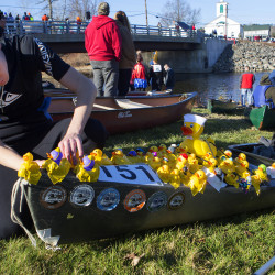 Kevin Stuckey tapes a few last minute ducks to his canoe before the start of the the 50th annual Kenduskeag Stream Canoe Race on Saturday.