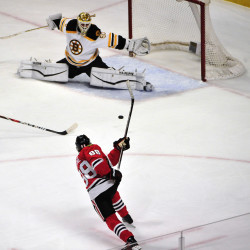 Chicago Blackhawks right wing Patrick Kane (bottom) shoots and scores on Boston Bruins goalie Jonas Gustavsson during the second period at the United Center.