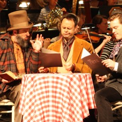 """Eric Mihan as Colline (left), Aaron Engebreth as Schaunard (center) and Dan Kempson as Marcello (right) rehearse a scene Saturday from Act Two of """"La Boheme"""" at the Collins Center for the Arts with the Bangor Symphony Orchestra."""