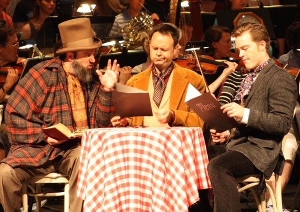 Eric Mihan as Colline (left), Aaron Engebreth as Schaunard (center) and Dan Kempson as Marcello (right) rehearse a scene Saturday from Act Two of &quotLa Boheme&quot at the Collins Center for the Arts with the Bangor Symphony Orchestra.