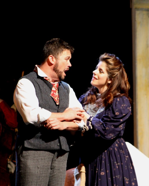 John Bellemer as Rodolfo and Emily Birsan as Mimi express their growing love for one another during a dress rehearsal Saturday for the Bangor Symphony Orchestra's production of &quotLa Boheme&quot at the Collins Center for the Arts.