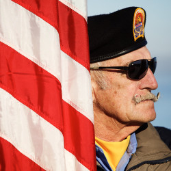 Color guardsman Bill Kiley of American Veterans Post 6 in New Gloucester listens as Gov. Paul LePage speaks during a Pearl Harbor remembrance ceremony at Fort Allen Park in Portland in this December 2015 file photo.